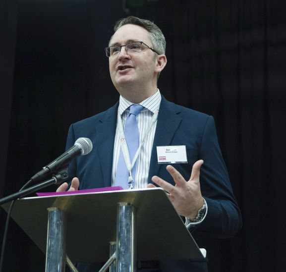 Simon Cook, principal of MidKent College, introduces the day